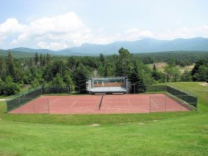 Tennis courts from the veranda. Mt. Washington, the tallest peak in the Presidential range, is in the background. Not so dramatic here