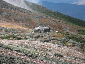 The Lakes hut from the top of Mt. Washington, Mt. Monroe and tundra garden also seen. A speck in the wilderness