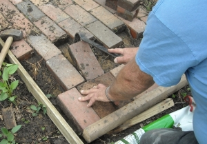 Bob filling the black hole and refitting bricks to the path.