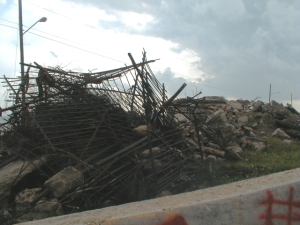Debris piles, some created by Katrina, others by people clearing property