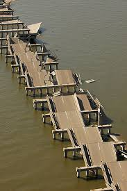 Bay St. Louis Bridge. Pilings dislocated by surge causes pavement to accordion. Check out new bridge in Part IV