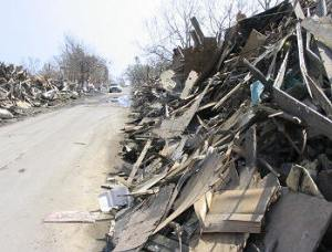 Debris pushed to the sides of a street in Waveland