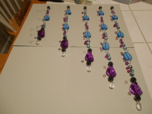 Here's a layout of dangles that will differ in length when hung