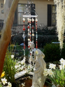 Red/black/crystal hanging above Ariadne in the pond
