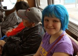 The girl with blue hair on the bus. Photo by Susan