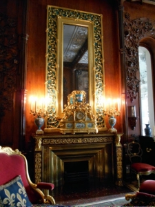One of many ornate fireplaces